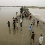 flood effected people using higher groud to reach safe areas