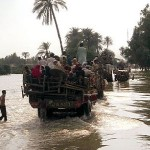 flood effected people going to safer areas in relief trucks.