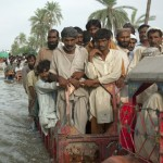 flood effected people trying to reach safer areas.