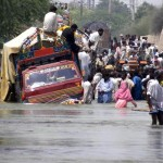 flood effected people trying their best to save their belongings.